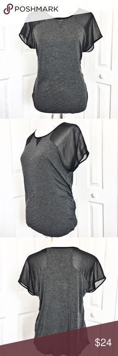 """Kensie T-Shirt Soft and comfortable with just a touch of sexy.  Gray t-shirt style with mesh sleeves.  Can be dressed up or down.  Shirt material is 100% viscose and sleeves are made of 100% polyester.  Measurements laid flat:  bust 20"""" and length from top of shoulder to hem 23.5"""".  EUC. Kensie Tops Tees - Short Sleeve"""
