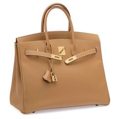 "A NATURAL COURCHEVEL LEATHER BIRKIN 35 BAGHERMÈS, 1999Gold Hardware, interior is Natural Chèvre Leather with one slip pocket and one zip pocket. Includes lock, keys, clochette, and dustbag.14"" W x 10"" H x 7.5"" DBlindstamp C Square"