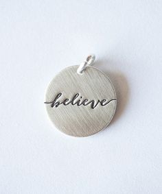 Love this Sterling Silver 'Believe' Charm by Five Little Birds Jewelry on #zulily! #zulilyfinds