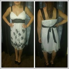 Beautiful B&W Dress Gorgeous all occassion dress. Features a black flower pattern, thick black belt below chest which is fully attached and ties in the back. Jeweled pieces on shoulder straps for a touch of glitzy glam. Steppin' Out Dresses