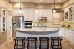 Traditional Kitchen with Built-in bookshelf, Complex granite counters, Flush, Limestone Tile, Cascade Roman Shade, L-shaped
