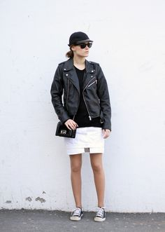 Converse, skirt from Acne, biker jacket from Gina Tricot, sweater from Anine Bing, sunglasses from Ray Ban, necklace from Efva Attling and bag from Tosca Blu. (image: sarastrand)