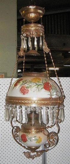 A 19th century Miller hanging lamp, hand painted carnations on opal glass, w/luster drops