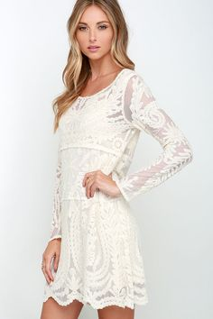We can't take our eyes off the amazing Black Swan Heidi Cream Lace Long Sleeve Dress! A lightweight lace overlay is beautifully decorated in symmetrical floral embroidery across the semi-sheer long sleeves, and shift bodice. Attached knit mini dress lining with adjustable spaghetti straps beneath. Dress is lined. Self:70% Cotton, 30% Nylon. Lining: 100% Polyester. Hand Wash Cold.