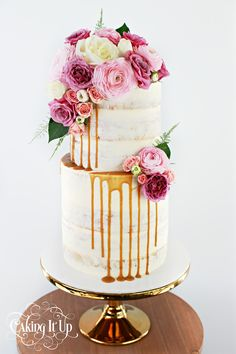 2 tier semi naked salted caramel drizzle cake with fresh flowers  www.facebook.com/cakingitup