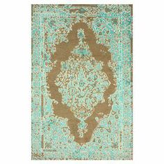 Define an area in your living room or master suite with this hand-knotted wool and art silk rug, showcasing an overdyed Persian-inspired motif.   Product: RugConstruction Material: Art silk and woolColor: Brown and aquaFeatures:  Hand-knottedMade in India Note: Please be aware that actual colors may vary from those shown on your screen. Accent rugs may also not show the entire pattern that the corresponding area rugs have.