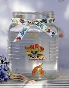 Aww take a used candle jar and give a little goldfish a new or temporary home. Clean u p the jar first please