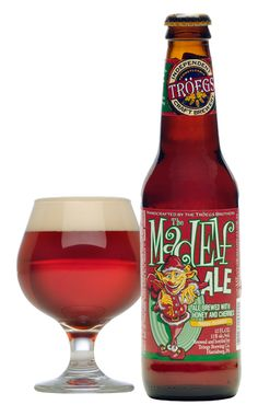 """The holidays at Tröegs start with our inner Mad Elf momentarily taking over the brew deck. So blame""""him""""forthis cheerful ruby red creation reminiscent of ripened cherries, raw honey and cocoa withnotesof cinnamon, clove and allspice."""