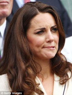 Tense: Kate bites her llip as she watches the Murray match - her faces are GREAT