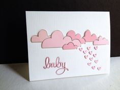 "I'm in Haven. The baby shower card was made by layering the pink textured paper on the layered white leftover pieces. I used a Simon Says Stamp baby die as well as the bottom portion of a Simon die: Heart Rainfall (minus the cloud...I cut with my all purpose snippers). I die cut the ""baby"" and the ""heart drops"" onto the card, then layered and fit the layered sentiment and hearts into the die cut holes. SSS Cloud Bank Craft Die."