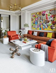 In a Manhattan family room, the ceiling is sheathed in a Maya Romanoff brushed-metal-leaf wallpaper. The chairs are covered in a vibrant Manuel Canovas fabric.