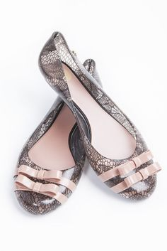 I love these beautiful plastic shoes from Melissa Shoes from our pretty boutique! The lace print has a ballerina feel to it. £50. From the AW12 collection from Melissa plastic shoes.