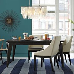 West Elm--Capiz shell pendant {this would look great in our dining room}