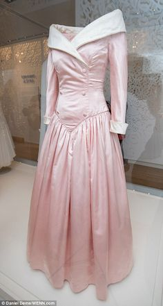 It's the Disney-esque fairytale gown every little girl dreams of wearing, complete with elegant sleeves and a full, flowing ballgown skirt, pictured in the exhibition