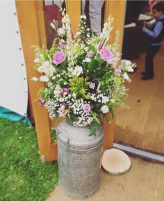Milk churns country natural wedding arrangement / http://www.deerpearlflowers.com/rustic-country-milk-jug-wedding-ideas/