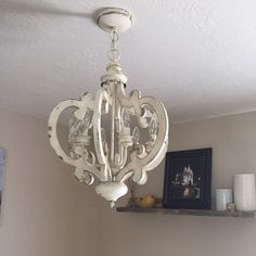 Free Shipping on this item ! This stunning chandelier will add an elegant touch to your home décor. Use it in your entryway, porch, hallways, dining room or eat-in kitchen. Finished in antiqued white