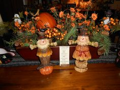Red Trencher filled with Fall Foliage and Pumpkins at The Old Mercantile in Clarksville Tn. Call 931-552-0910 for shipping. Like and Follow on Facebook.