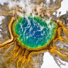 Photo @Chrisburkard. It's amazing what a few thousand feet of elevation will do to a landscape. Over the years flying has become something I've become obsessed with. It's such a refreshing change of perspective and can turn an often photographed location into something unique. From 2000 feet all the colors of Yellowstone National Park's Grand Prismatic Spring in Wyoming becomes evident. When you see it from this perspective, you can't help but wonder how something like this comes to be…