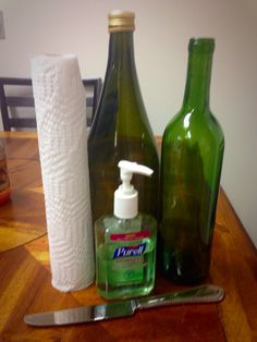 How to remove wine bottle labels in 3 minutes!   Get a bottle of hand sanitizer, a couple paper towels, a butter knife, and an empty bottle. Peel off as much of the label as you can. Don't worry if there is any left. Rub two or three squirts of sanitizer on the label. Using the back of your knife, rub back & forth quickly. After you have gotten the paper off, repeat this process on the glue until most is removed. Using a paper towel, wipe off the remaining glue and VOILÀ! Clean wine bottle!