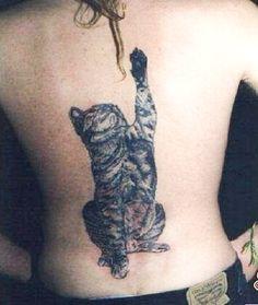Playful cat tattoo