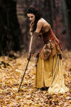 My name is Alenora, or as some people call me, the Witch of the woods. I'm a travelling gypsy and I can often be found in the woods or dancing through the town. I admit music. My life resides around singing and dancing, but be warned, cross my path and you may never find yours again.
