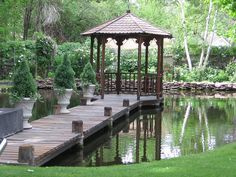 gazebo over the pond. Must be a big backyard! Gorgeous!