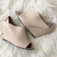 Wedges Very beautiful light nude/pink wedges. Worn once for 2 hours. Comes with original box Shoes Wedges