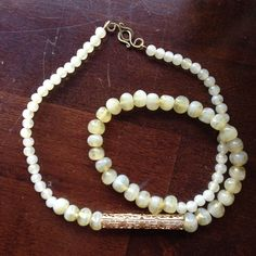 Anthropologie Jade-Look Necklace w/ Gold Filigree Excellent Used Condition. Barely worn. Looks like the more yellow-toned green form of jade. All beads are flawless as is the clasp. Beads are graduated sizes accented with a gold filigree piece. Very nice weight to the necklace. Anthropologie Jewelry Necklaces