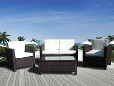 Get Miami Beach Furniture by purchasing this 4Pc Rattan Wicker Sofa Set with Wicker Chairs, a Wicker Coffee Table, and Cushions by The Miami Beach Collection.