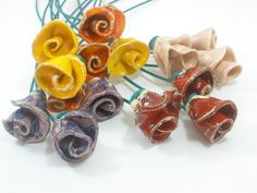 One of a kind set of 9 Colorful ceramic flowers