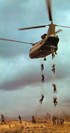Ladders allowing soldiers to climb into the helicopter during the Vietnam War. via Reddit.