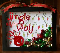 LOVE this in a shadow box! some jingle bells, ribbon, vinyl and a shadow box