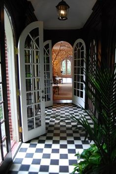 hallway checkerboard tile floor checker board black and white curved archway arch. Reminds me of my grandparents apartment in Jackson heights! Arched Doors, Windows And Doors, Kim House, Checkerboard Floor, Checkered Floors, Black And White Tiles, House Entrance, Interior Architecture, Interior Decorating