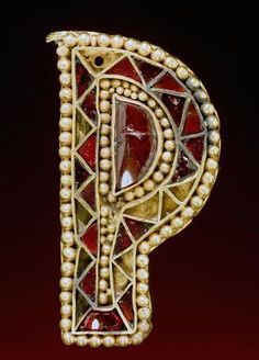 P-shaped piece of jewelry, decorated with different colored beads and gemstones,    Roman-Germanic , 5th century A.D.