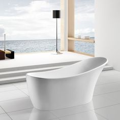 """Slide comfortably into this kingly bathtub with an asymmetrical design that functions as a backrest. The precise molding of the white acrylic reflects a breezy, coastal style. Wash away stress and tension as you submerge into this beautifully contemporary freestanding tub. AKDY 63"""" Freestanding Soaking Bathtub - AZ-F278"""
