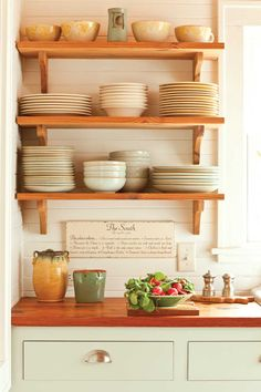 Green cabinet + wood counter tops + open shelving + beadboard background = PERFECT