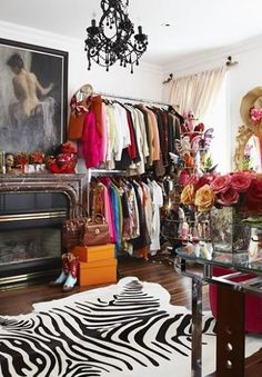 Olivia Palermo's closet - I love the idea of putting art at the centre of all the clothes. Art does imitate life and clothes are the way we express ourselves. I have just the picture to do hang like that in my new room!