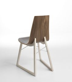 Ray / Design: Orlandini Design, 2010 / The name and the X that distinguish the front of this collection structure are a clear reference to Charles and Ray Eames. The comfortable curved plywood seat is supported by a sled made of wood or chrome rod, giving the Ray chair a strong aesthetic presence.