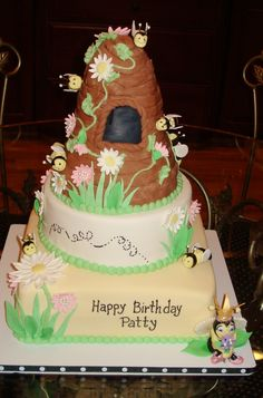 Bees and daisies...Queen Bee cake - beehive cake for my sister's birthday...Fondant covered cake, fondant bees & daisies