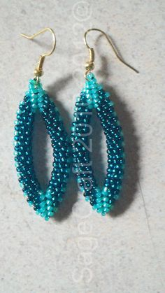 "Teal earrings from Diane Fitzgerald's book ""Shaped Beadwork."""