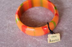 1960's Vintage Lucite Striped Bangle New with Tags, New Old Stock by BakeliteQueen on Etsy https://www.etsy.com/listing/183133142/1960s-vintage-lucite-striped-bangle-new