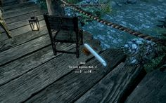 A lonely Skyrim guard post - a well-thumbed copy of The Lusty Argonian Maid and a 'roll of paper' hopefully unused. #games #Skyrim #elderscrolls #BE3 #gaming #videogames #Concours #NGC