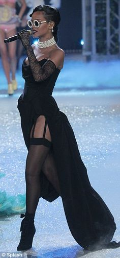 Back to black: Rihanna wore a black dress with a huge cut in that showed off her stockings on the catwalk