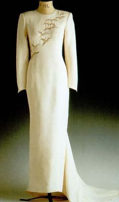 Designed by Catherine Walker, this cream silk dinner dress embroidered with gold and silver falcons raised $ 35,650 at the Christie's auction in 1997. The Princess of Wales wore this dress on a state visit to Saudi Arabia, and a doll in the likeness of Diana was made by the Franklin Mint wearing this dress.
