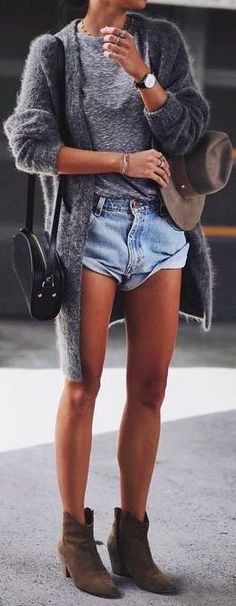 street style. denim shorts. ankle boots. knit cardigan. tee.