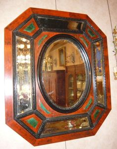 Octagonal mirror style #LouisXIV. #Beveled mercury grass, and beveled #mirroded #panels. Polychrome wood frame in red and green tones, making #tortoiseshell and #malakite. NapoleonIII, 19th century. For sale on Proantic by Buhard Jean Yves.