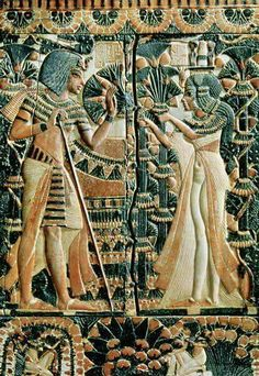 Plaque from the lid of a coffer showing- (c.1370-1352 BC) and his wife Tutankhamun- Ankhesenamun-in a garden.
