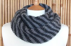 """This unisex cowl is knitted on the bias in 2 colours, creating diagonal stripes. It's """"splendid"""" because it knits up really quickly, looks fabulous and is extremely cosy. You could knit the cowl as wide or as long as you like, depending on how much yarn you have; the yardage mentioned in the pattern is just a guide. Gauge isn't really important either."""