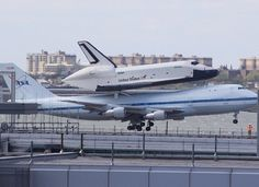 The Space Shuttle Enterprise Touches Down At JFK