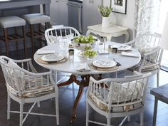 A fresh coat of white paint gives a tired wooden table and bamboo chairs new life.